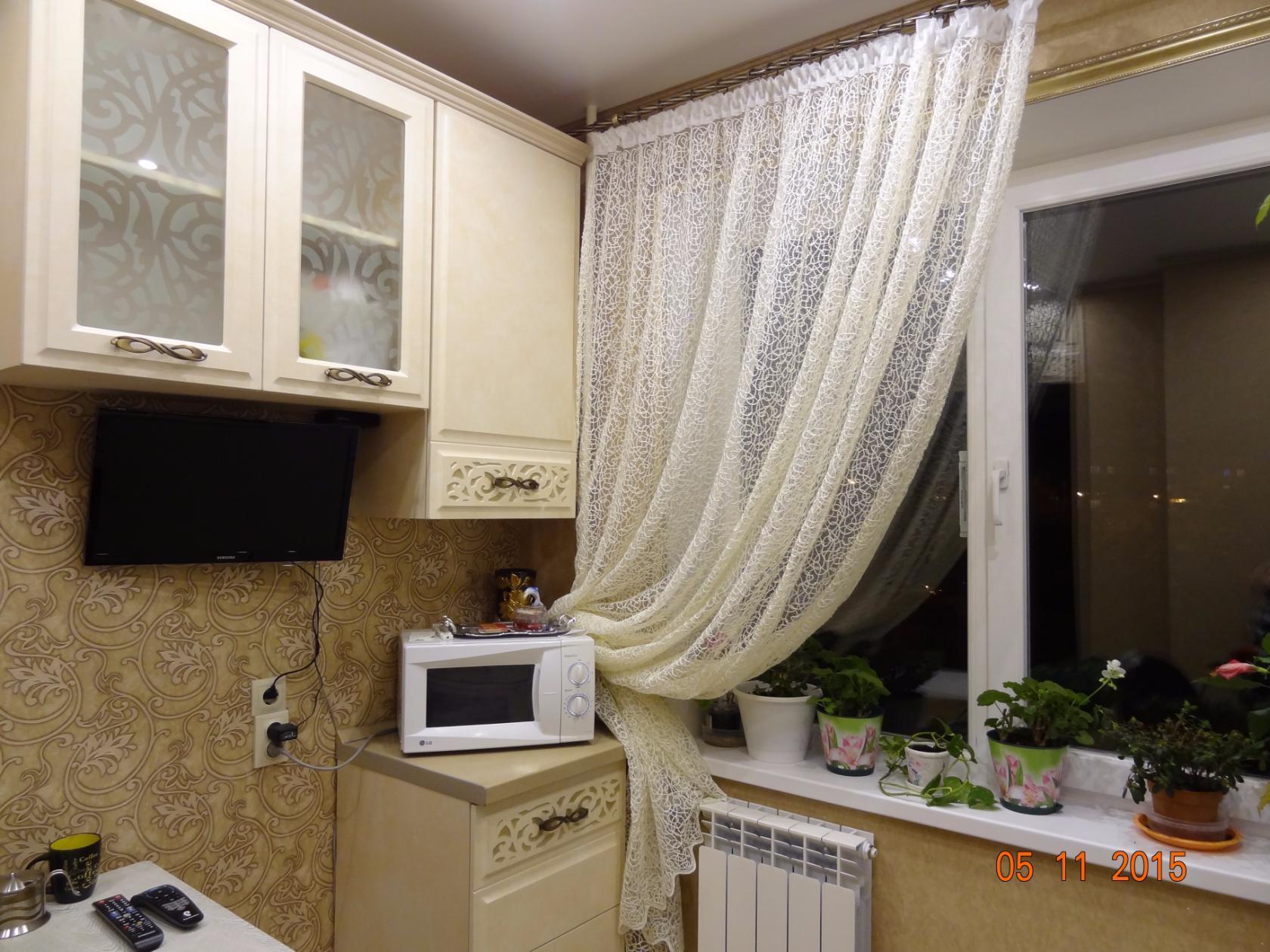 Cocina color beige marrón de la foto